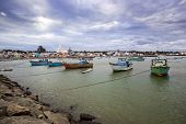 stock photo of kanyakumari  - Fishing harbor with large church in background - JPG