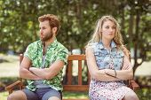 pic of not talking  - Young couple not talking after argument on a summers day - JPG