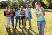 picture of peer-pressure  - Student being bullied by a group of students on a sunny day - JPG