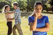 picture of breakup  - Man being unfaithful in the park on a sunny day - JPG