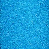 pic of crystal salt  - Surface covered with colored blue salt crystals as a background - JPG