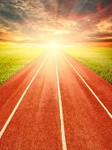 picture of track field  - Running track in field with sky and clouds  - JPG