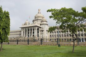image of vidhana soudha  - Government building viewed from a garden - JPG