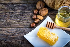 picture of honeycomb  - honey dipper and honeycomb nuts in honey and nuts of various kinds - JPG