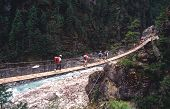 Trekkers Crossing River