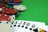 image of flush  - Royal flush and poker chips heap background - JPG