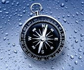picture of raindrops  - Black compass on the blue raindrop background - JPG