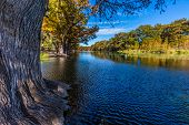 picture of crystal clear  - Bright Beautiful Fall Foliage On The Crystal Clear Frio River at Garner State Park - JPG