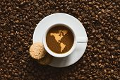 image of continent  - Still life photography of hot coffee beverage with map of America continent - JPG