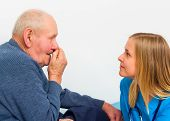 foto of influenza  - Elderly man with influenza symptoms at the doctor for a medical check - JPG