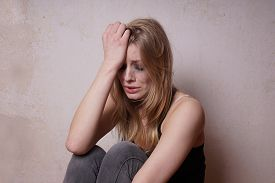 stock photo of weeping  - sad young woman with tear - JPG