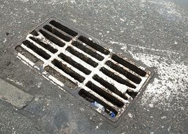 picture of cross-hatch  - Drain grate on the road with old white road marking line  - JPG