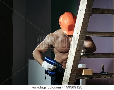 Sexy Muscular Man Builder On Ladder