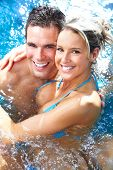 foto of hot-tub  - Young loving couple relaxing in the water - JPG