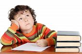 stock photo of person writing  - adorable boy studying a over white background - JPG