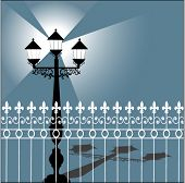 lamppost with shadow and fence