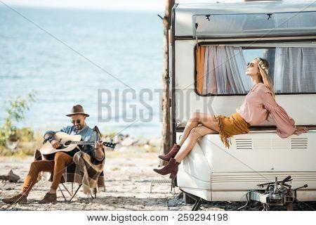 Attractive Girlfriend Sitting On Trailer