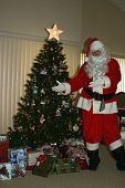 santa shows off the presents he just left