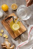 Cup Of Ginger Tea With Lemon. Cup Of Ginger Tea With Lemon. Glass Mug Of Green Hot Tea On Wooden Tab poster