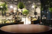 Selected Focus Empty Brown Wooden Table And Coffee Shop Or Restaurent Blur Background With Bokeh Ima poster
