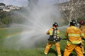 LAGUNA BEACH, CA - FEB 19: Firefighter recruits in action during fire fighting drills at the local F
