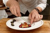 Chef is serving foie gras with berry sauce, haute cuisine French starter poster