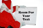 stock photo of santa claus hat  - Santa Claus reads from his list with room for your text isolated on white - JPG