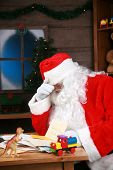 Santa Claus has a Head Ache from being over worked and stress before christmas