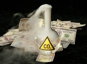 a 500ml beaker filled with CO2 infront of a pile of money, representing the business interest behind