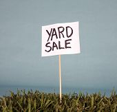 yard sale sign in grass