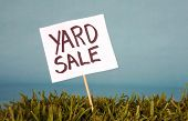 stock photo of yard sale  - yard sale sign in grass - JPG