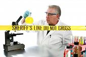 forensic analysis working in a lab collecting and documenting evidence collected from a crime scene.