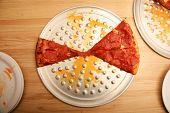 picture of pizza parlor  - the remaining slices of a classic pepperoni pizza - JPG