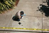 CSI Crime Scene with Chalk Outlines and Sheriff do not cross caution tape. shot outside in direct da