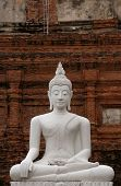 Stone statue of Buddha in the temple of Wat Yai Chai Mongkol in Ayutthaya, Thailand
