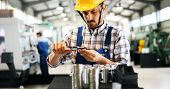 Industrial Factory Employee Working In Metal Manufacturing Industry poster
