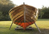 picture of old boat  - Old wooden boat winter storaged on lawn - JPG