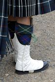 Foot Detail Of A Scottish Soldier In Ceremonial Kilt