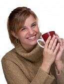 Young Woman With Pony Tail Holding A Mug Of Hot Chocolate,