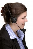 Attractive Professional Young Woman Wearing A Telephone Headset