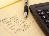 foto of budget  - yellow legal pad with calculator and pen with budget written on pad - JPG