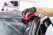 A Man Cleaning Car With Microfiber Cloth, Car Detailing (or Valeting) Concept. Selective Focus. Car  poster