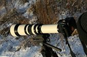 Big telephoto lens on slr photo camera