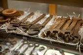 Chocolate Bars With Shape Of Workshop Tools. Assorted Chocolate Candy Shop. Shop-window Of Confectio poster