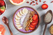 Acai Smoothie Bowl With Superfoods. Smoothy Bowl Topped With Banana, Chia Seed, Coconut, Strawberry  poster