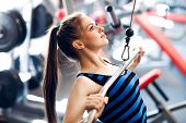 Young Woman Exercising. Fitness Physical Exercise In Gym. poster