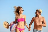 Young Couple In Beachwear Spending Time Together Outdoors poster