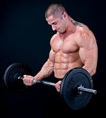 pic of muscle man  - Man with a bar weights in hands training - JPG