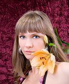 fashion woman portrait with a beautiful flower