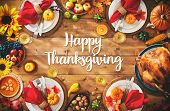 Thanksgiving celebration traditional dinner setting meal concept with Happy Thanksgiving text poster